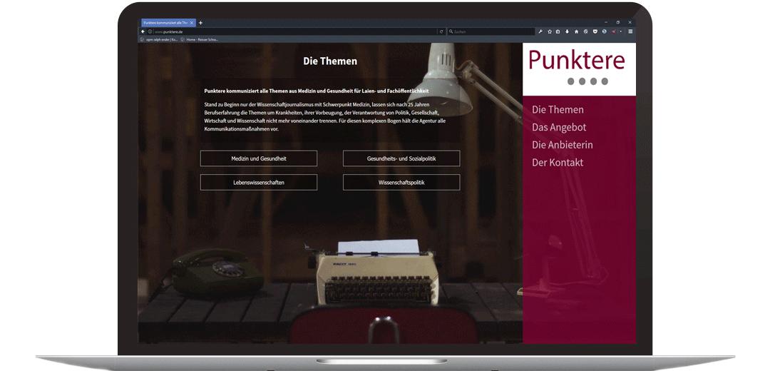 Beispielhafte Website auf einem großen Display von opm ralph ender